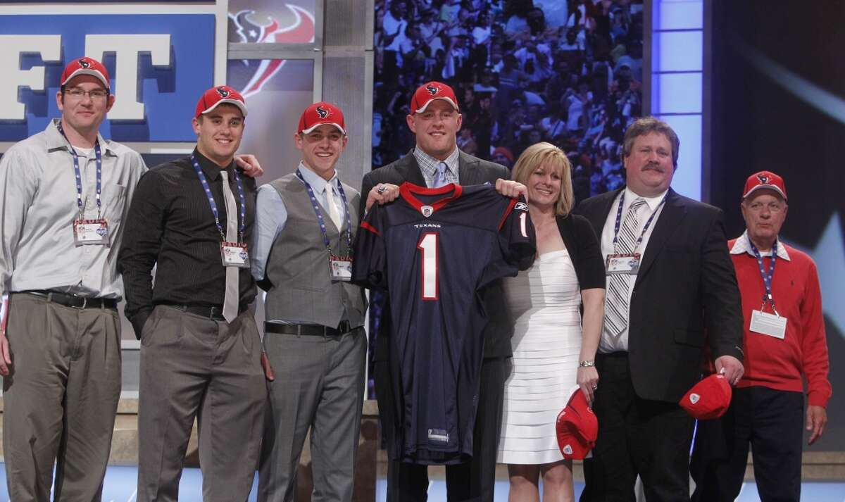 2011 Wisconsin defensive end J.J. Watt poses for photographs with guests after he was selected as the 11th overall pick by the Houston Texans in the first round of the NFL football draft at Radio City Music Hall on Thursday, April 28, 2011, in New York. (AP Photo/Jason DeCrow)