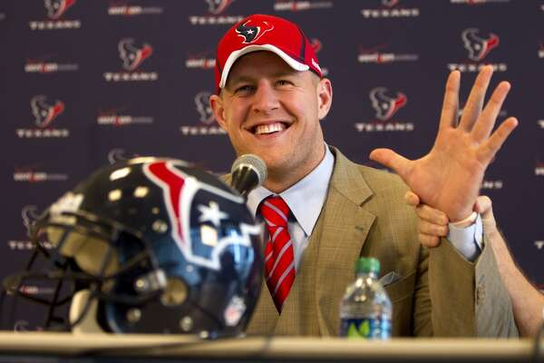 2011      Houston Texans first round draft pick J.J. Watt, a defensive end from Wisconsin, smiles as his hands is held up by defensive coordinator Wade Phillips during a news conference at Reliant Stadium Friday, April 29, 2011, in Houston. Watt was chosen by the Texans as the 11th pick in the first round of the NFL draft. ( Brett Coomer / Houston Chronicle )