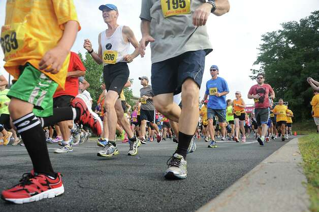 Runners begin the SEFCU Labor Day 5k Race on Monday, Sept. 1, 2014 in Albany, N.Y.  (Lori Van Buren / Times Union) Photo: Lori Van Buren / 00028402A