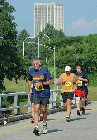 Runners participate in the SEFCU Labor Day 5k Race on Monday, Sept. 1, 2014 in Albany, N.Y.  (Lori Van Buren / Times Union) Photo: Lori Van Buren / 00028402A