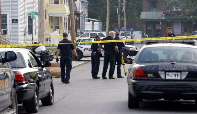 Schenectady police investigate a murder on Catherine Street. (Skip Dickstein/Times Union)