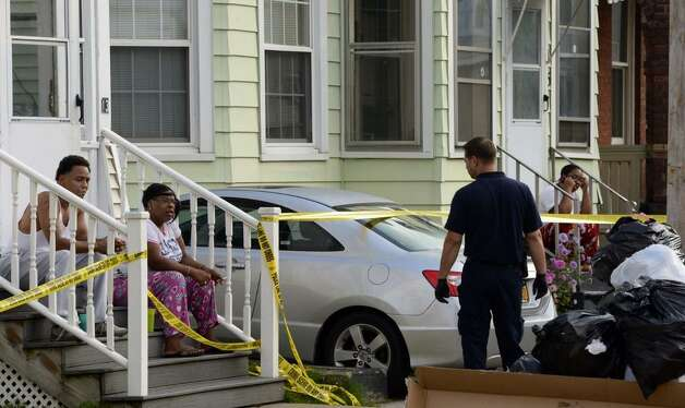 Police speak with neighbors at the scene of a murder on Catherine Street in Schenectady. (Skip Dickstein/Times Union)