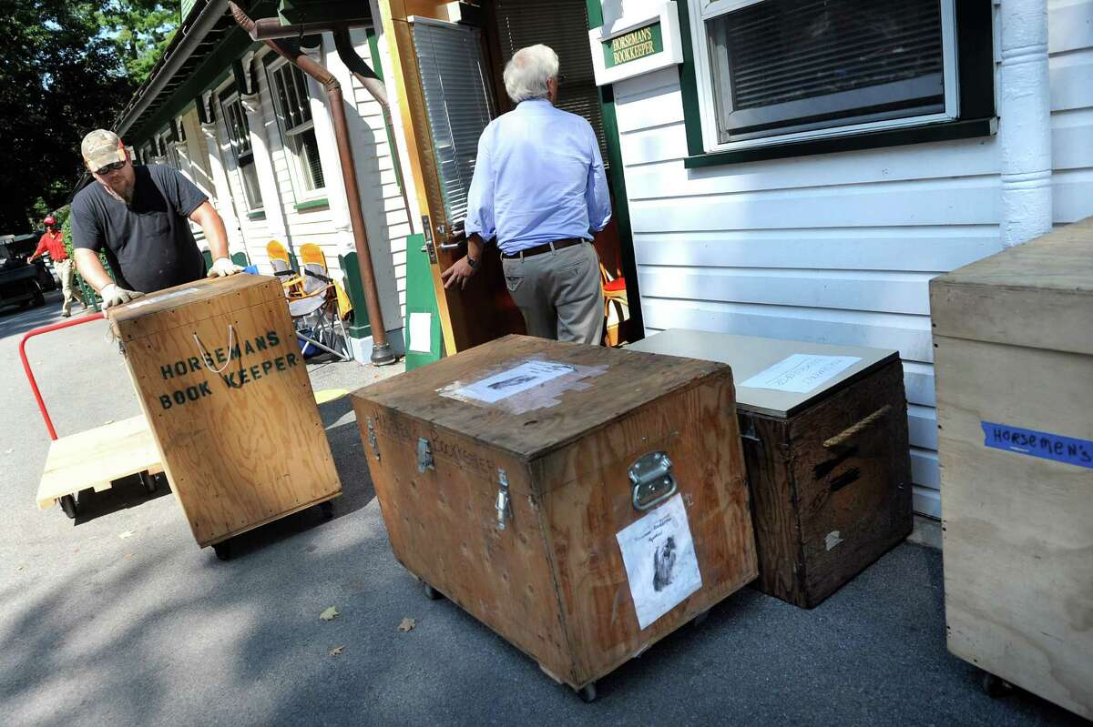 NYRA employee Andy Signer, left, moves trunks for the Horsemans' bookkeeper on the final day of thoroughbred races on Monday, Sept. 1, 2014, at Saratoga Race Course in Saratoga Springs, N.Y. (Cindy Schultz / Times Union)