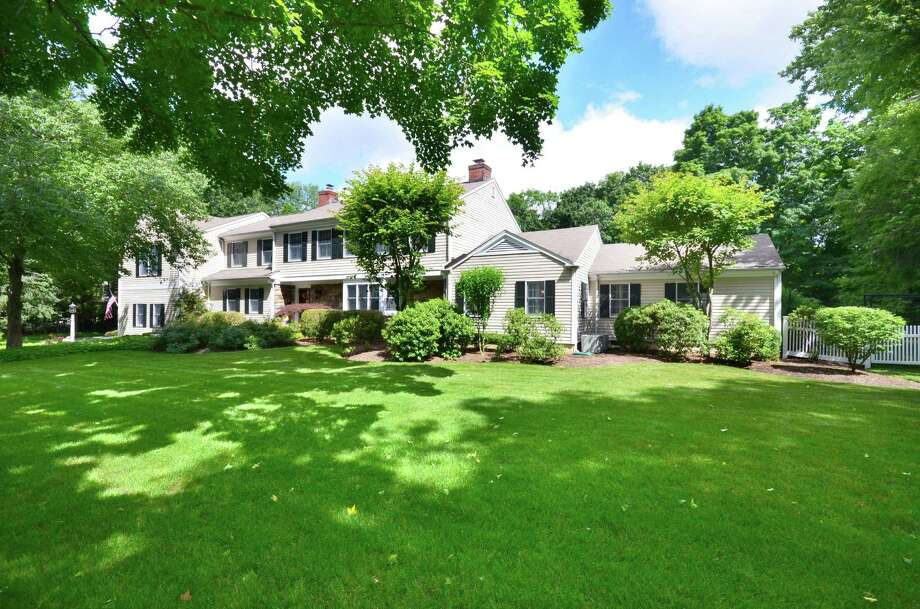 The classic Colonial at 39 Parade Hill in New Canaan is conveniently located near the center of town and the train station. It is on the market for $2,350,000. Photo: Contributed Photo, Contributed / New Canaan News Contributed