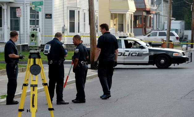 Schenectady Police Crime Scene investigators work the scene of a homicide on Catherine Street Tuesday morning Sept. 2, 2014 in Schenectady, N.Y.  The homicide occurred approximately 11:30 last evening.     (Skip Dickstein/Times Union) Photo: SKIP DICKSTEIN / 00028416A
