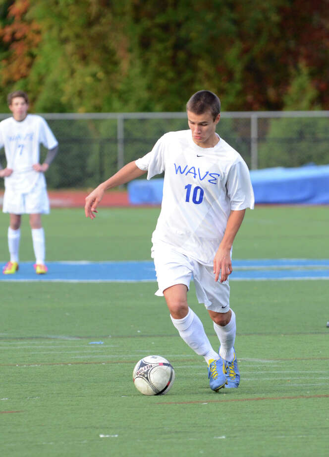 Darien's Kai Bjornstad controls the ball during a boys soccer game against Bassick at Darien High School on Wednesday, Oct. 23, 2013. Photo: Amy Mortensen / Connecticut Post Freelance