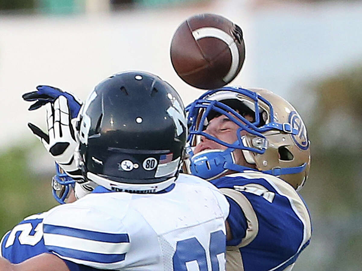Mule receiver Grant Biggs gets the ball on his helmet under pressure as Alamo Heights hosts New Braunfels at Orem Stadium on August 29, 2014.