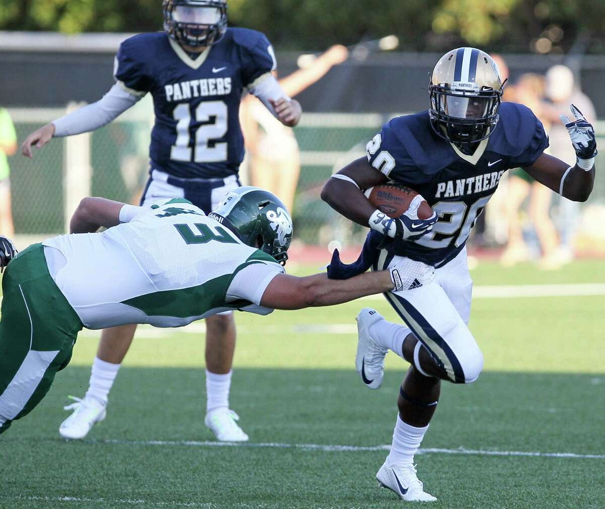 O'Connor's Jamontae Edwards, right, slips by Reagan's Jonathan Cox during their game on Saturday.