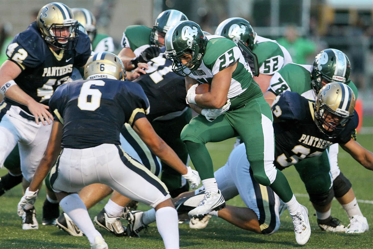 Reagan's Cody Martinez (23) looks for running room against O'Connor during the first half of their game at Farris Stadium on Saturday, Aug. 30, 2014. MARVIN PFEIFFER/ mpfeiffer@express-news.net
