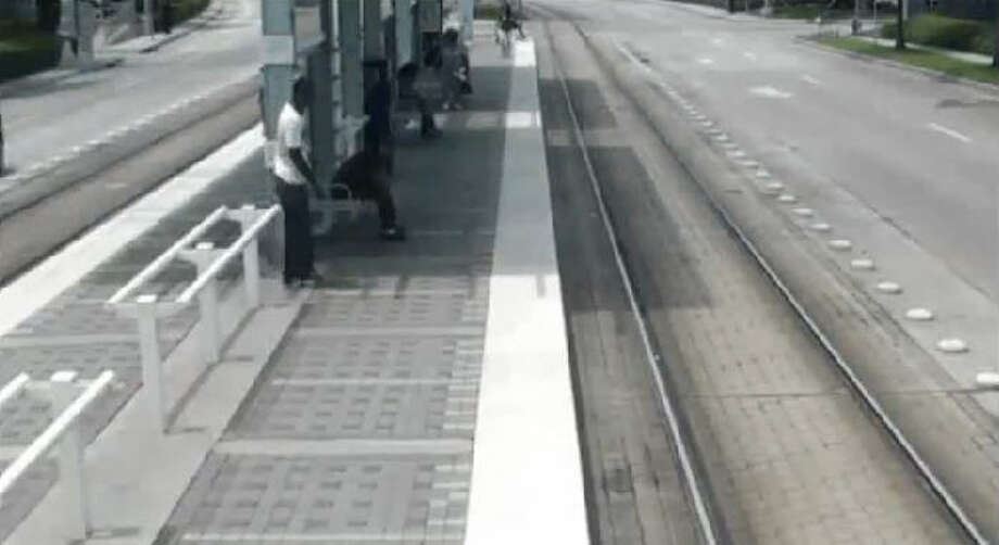 INCIDENT #1: The suspect casually walks past his victim, then snatches his target's belongings before dashing across the METRO tracks and disappearing. Photo: Houston METRO