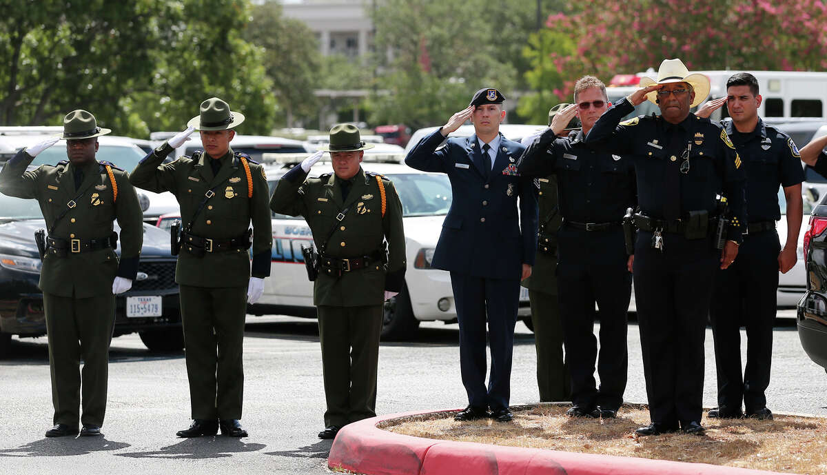 Law enforcement officers salute as the casket of Elmendorf Police Chief Michael Pimentel arrives at Cornerstone Church for funeral services, Tuesday, September 2, 2014. Pimentel was shot and killed on August 23. He was allegedly shot and killed by Joshua Manuel Lopez, 24, during a traffic stop. Lopez is now facing capital murder charges.