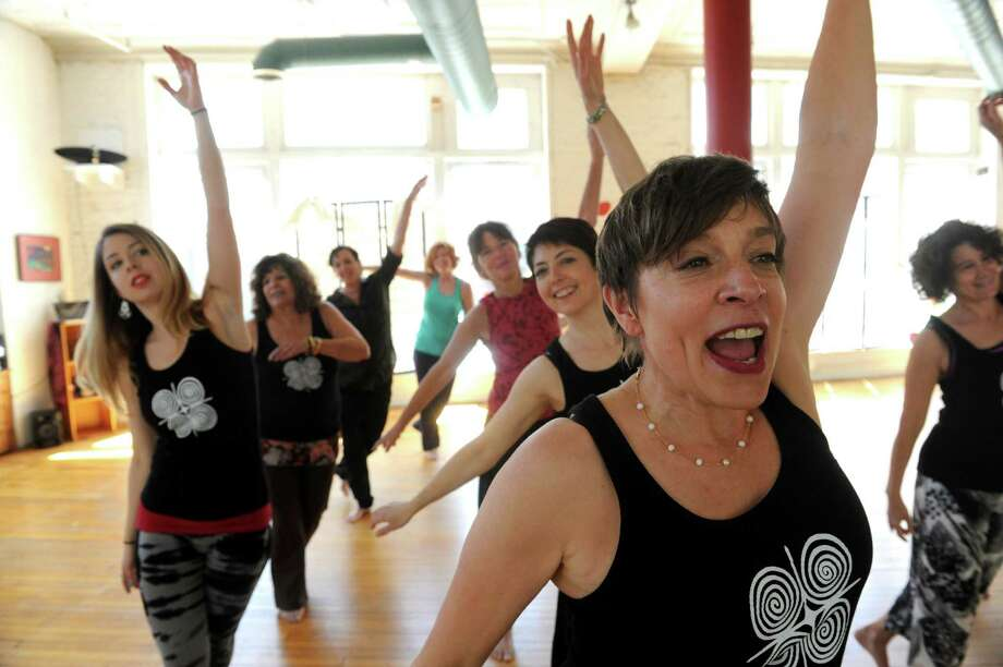 Nia Center founder Casey Bernstein leads a group on Friday May 3, 2013 in Albany, N.Y. A gala marking the 20th anniversary of the local Nia center and the 30th anniversary of the mind-body fitness program will be held Saturday on the 4th floor of 4 Central Avenue in Albany.(Michael P. Farrell/Times Union) Photo: Michael P. Farrell / 10022269A
