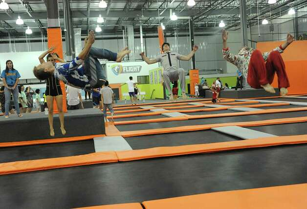 Members of the Cirque Eloize have fun doing flips as they visit Flight Trampoline Park on Wednesday, July 23, 2014 in Albany, N.Y. Cirque Eloize's iD, which combines modern circus skills and urban dance in a bright, high-powered mix, is coming to Proctors, Aug. 1-10.  (Lori Van Buren / Times Union) Photo: Lori Van Buren / 00027881A