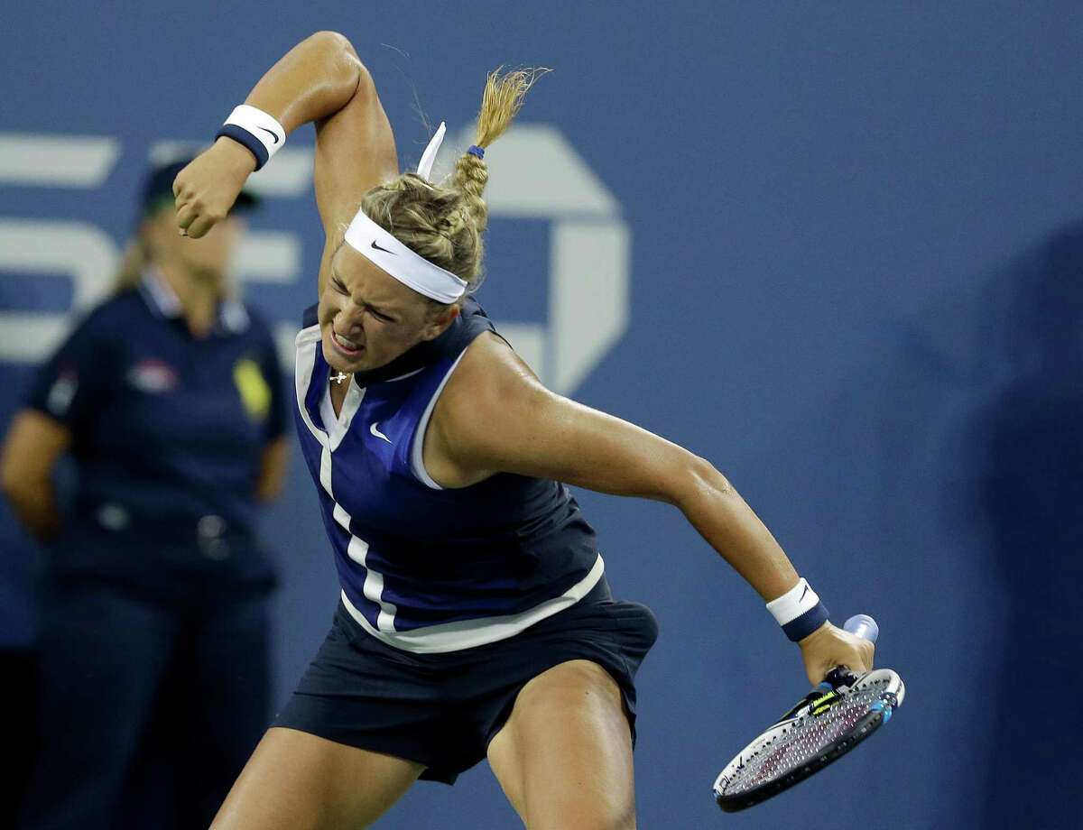 Victoria Azarenka, of Belarus, reacts after defeating Aleksandra Krunic, of Serbia, during the fourth round of the 2014 U.S. Open tennis tournament Monday, Sept. 1, 2014, in New York. (AP Photo/Darron Cummings) ORG XMIT: USO529
