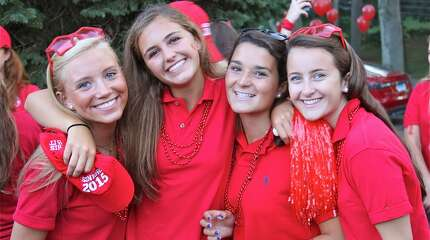 Greenwich Academy seniors celebrate the opening day of classes on Tuesday.  From left, are: Caroline Willke, Skylar Burdick, Kelly Clark and Kate Feeley