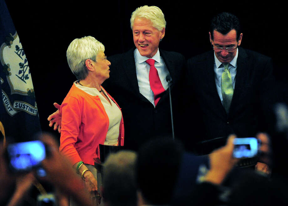 Former President Bill Clinton, center, stands with Lt. Gov. Nancy Wyman, left, and Gov. Dannel P. Malloy, during a campaign visit in support of the governor's re-election at the Omini Hotel in New Haven, Conn. on Tuesday, September 2, 2014. Photo: Brian A. Pounds / Connecticut Post