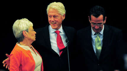 Former President Bill Clinton, center, stands with Lt. Gov. Nancy Wyman, left, and Gov. Dannel P. Malloy, during a campaign visit in support of the governor's re-election at the Omini Hotel in New Haven, Conn. on Tuesday, September 2, 2014.