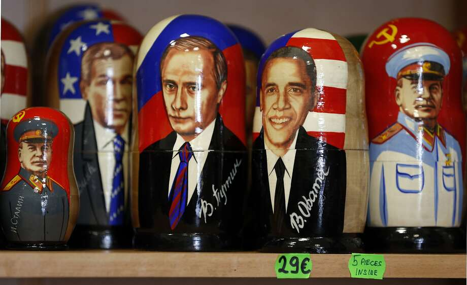 A traditional Russian Matryoshka wooden doll depicting US President Barack Obama, second from right, Russian President, Vladimir Putin, center, U.S. President George W. Bush, second from left, and Leader of the Soviet Union from the mid-1920s until 1953 Joseph Stalin, left, and right, on a display in Tallinn, Estonia, Tuesday, Sept. 2, 2014  (AP Photo/Mindaugas Kulbis) Photo: Mindaugas Kulbis, Associated Press