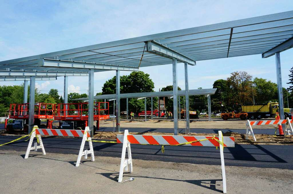 Solar panels are being installed in the parking lot of the Postol Recreation Center on Mill & Not so bright: Rec center solar-panel carports criticized by ...