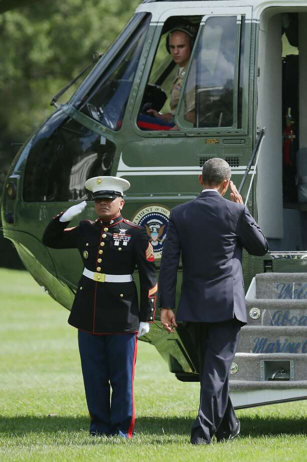 WASHINGTON, DC - SEPTEMBER 02:  U.S. President Barack Obama salutes before boarding Marine One and departing the White House September 2, 2014 in Washington, DC. Obama is traveling to Estonia and will join the NATO summit in Wales on Thursday.  (Photo by Chip Somodevilla/Getty Images) Photo: Chip Somodevilla, Getty Images