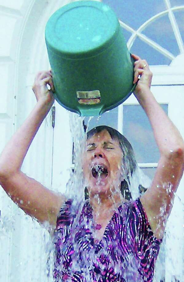 "A good sport  Enduring the ALS' ""ice bucket challenge' recently on the steps at Bryan Memorial Town Hall in Washington is town assessor Delisse Locher. She and fellow town hall staffers participated in support of the internationalyl viral ALS fundraiser. For more photos, see inside pages and visit www.newmilfordspectrum.com. August 2014   Courtesy of the town of Washington Photo: Contributed Photo / The News-Times Contributed"
