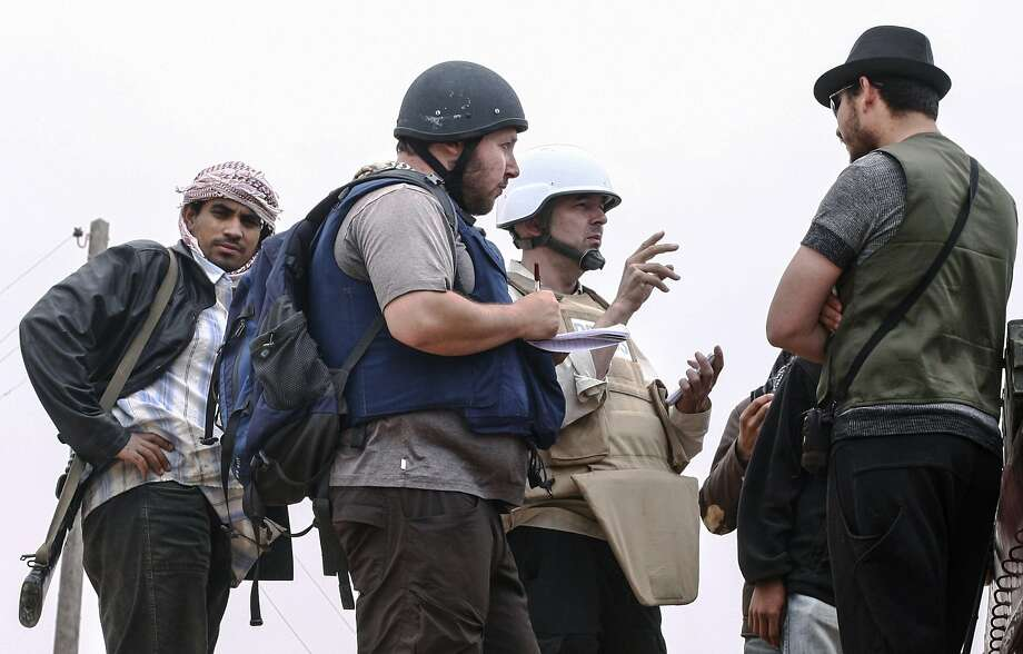 American journalist Steven Sotloff (Center with black helmet) was kidnapped in August 2013 near Aleppo, Syria and was recently shown on a jihadist video in which fellow US journalist James Foley was executed. On Sept. 3, 2014, the White House confirmed Sotloff had been executed by the Islamic State of Iraq and Syria or ISIS. Photo: Handout, Getty Images