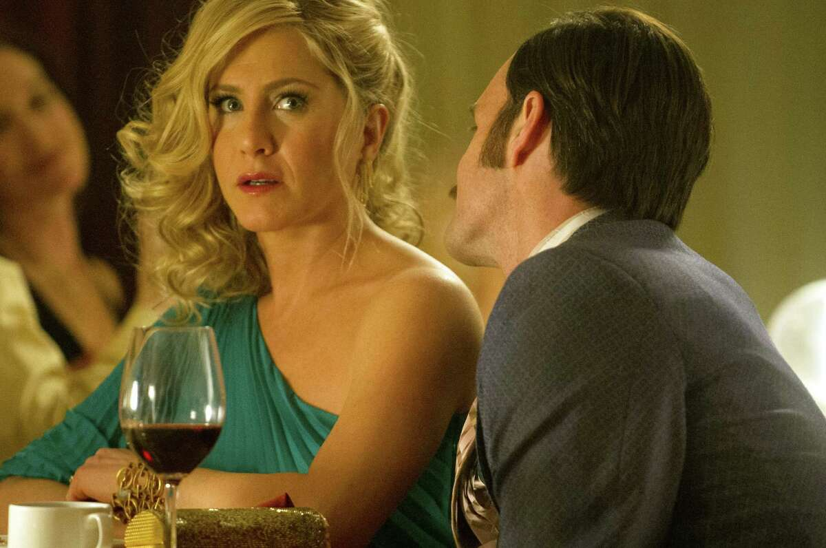 This image released by Roadside Attractions shows Jennifer Aniston, left, and Will Forte in a scene from