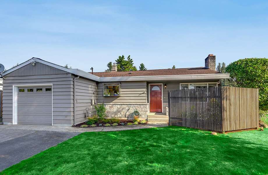 We'll start with the newest home, 1614 N.E. 137th St., which was built in 1959. It's 1,350 square feet, with three bedrooms, two bathrooms, a bonus room and a covered patio on a 7,255-square-foot lot. It's listed for $369,000. Photo: HD Estates,  Courtesy Sam Lamb/Lake & Company