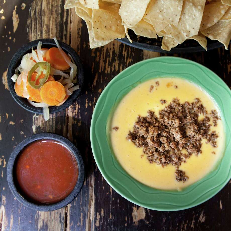 Chips, salsa, escabeche and queso at Molina's Cantina. Photo: Julie Soefer / handout