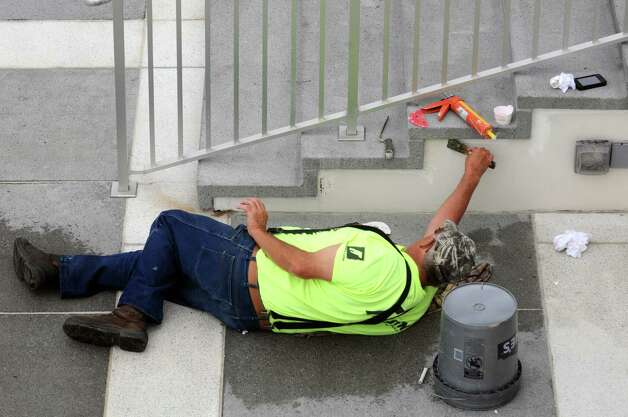 Mason Terry Lounsbury with Jersen Construction works on a stair case at UAlbany on Friday Aug. 22, 2014 in Albany, N.Y. (Michael P. Farrell/Times Union) Photo: Michael P. Farrell, Albany Times Union / 00028271A