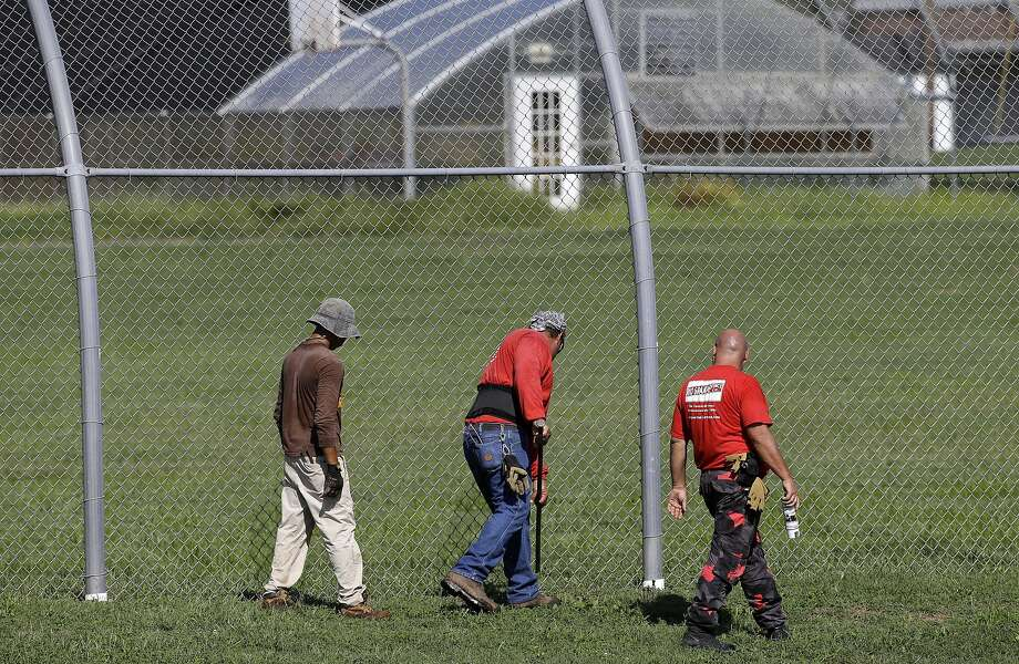 A crew checks for weak spots in the fence at the Woodland Hills Youth Development Center in Nashville. Photo: Mark Humphrey, Associated Press