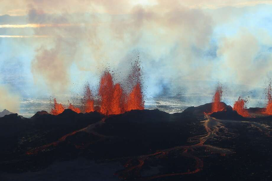 Fountains of lava up to 60 meters high spurt from a fissure on the north side of the Bardarbunga 