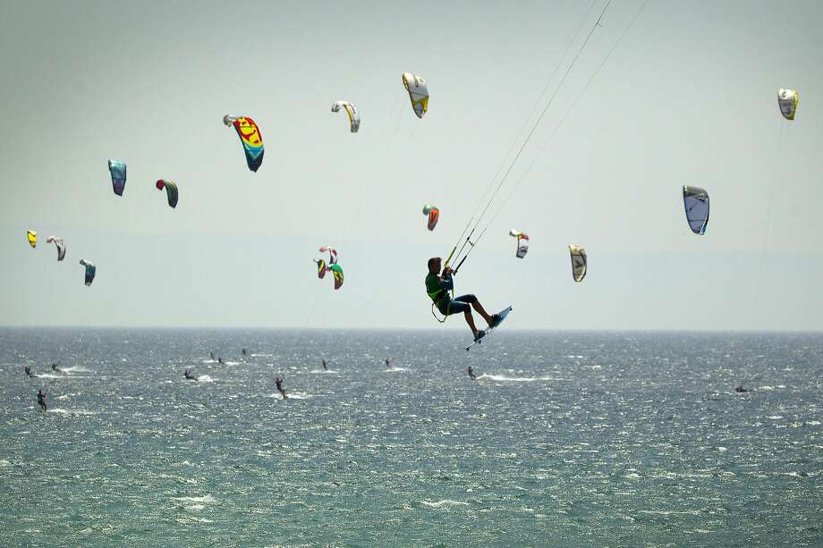 Go fly a kite - with 351 friends:A total of 352 kitesurfers tentatively set a new Guinness World Record for most kitesurfers sailing   together at one time in Tarifa, Spain. Photo: Sergio Camacho, Getty Images