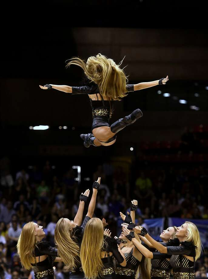 Cheerleaders launch a colleague at the FIBA World Basketball 