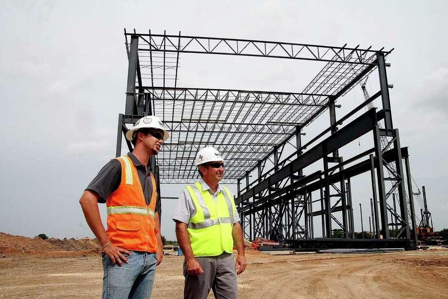 Alan Bishop and Brawny Gary are helping construct the MHI Compressor Manufacturing LLC building in Pearland. Photo: Pin Lim, Freelance / Copyright Pin Lim.