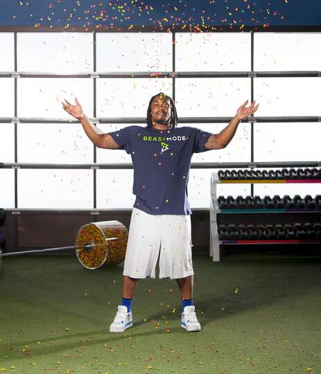 Marshawn Lynch basks in a shower of Skittles during his ...