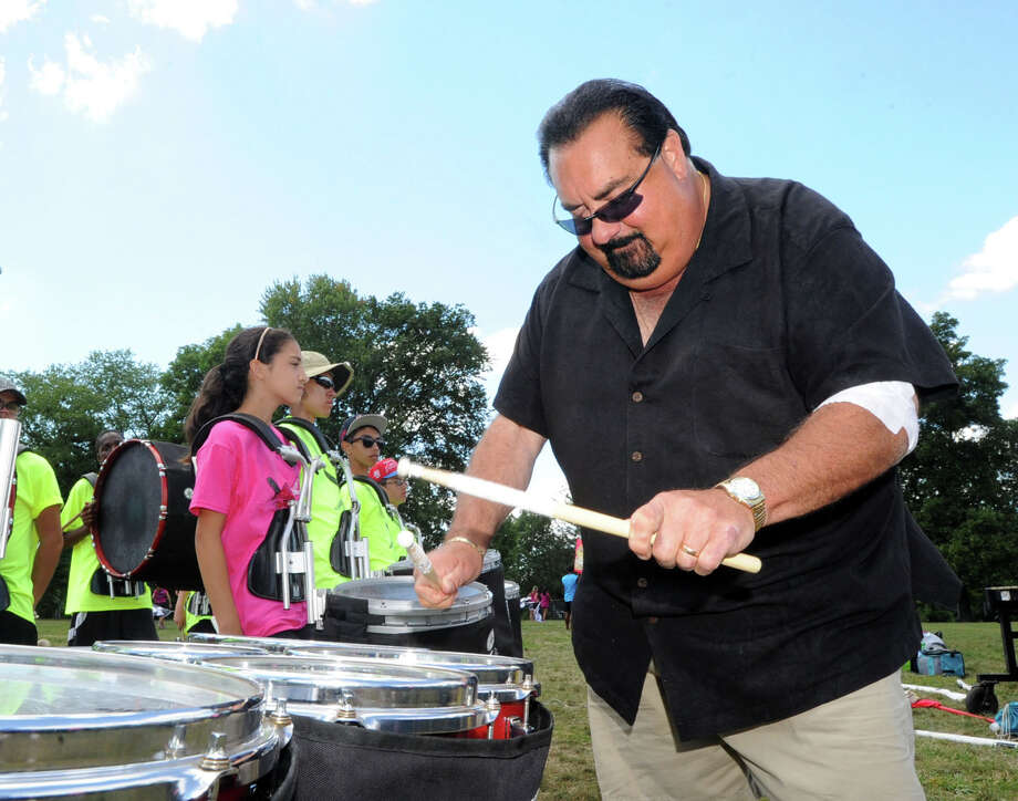 Greenwich resident, Bob Vitti, gives insturction during marching band camp at Crawford Park, Rye Brook, N.Y., Thursday afternoon, Aug. 28, 2014. Vitti, a musician and drumline teacher, is set to be inducted this weekend into the World Drum Corps Hall of Fame in Rochester, N.Y. Vitti first began playing drums with the Greenwich Boys & Girls Club in 1960. Photo: Bob Luckey / Greenwich Time