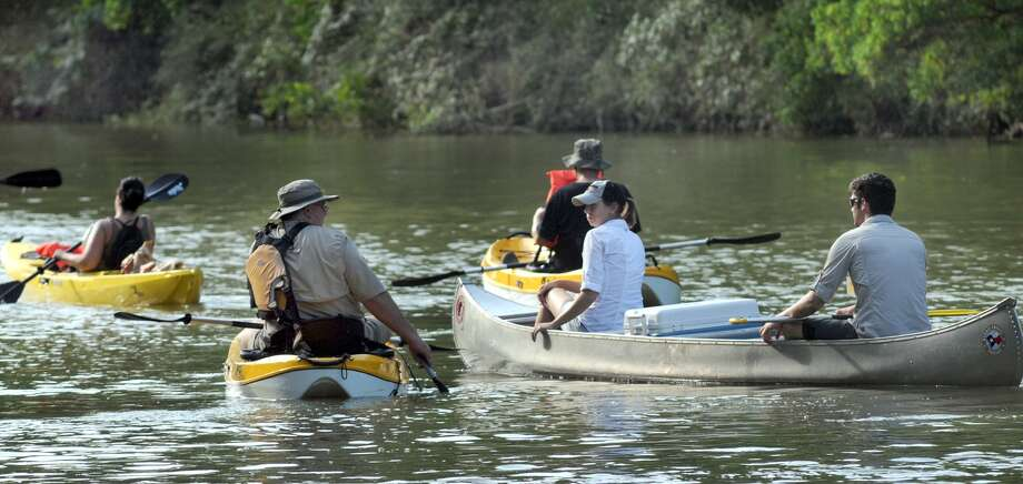 "Harris County Precinct 4 Commissioner Jack Cagle, left, paddles on Spring Creek during the ""Canoes, the Creek and the Commissioner"" event at Jesse H. Jones Park and Nature Center. Cagle will be part of the Cypress Creek Regatta Sept. 13, hosted by Bayou Preservation Association and Bayou City Adventures. Photo: Jerry Baker, Freelance"
