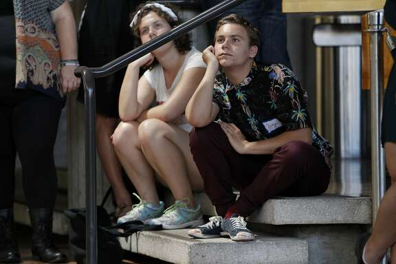 Sage Ryan listens to speakers during an orientation for theater students in the lobby of Zellerbach Hall on the Cal campus in Berkeley, CA, Wednesday, August 27, 2014.