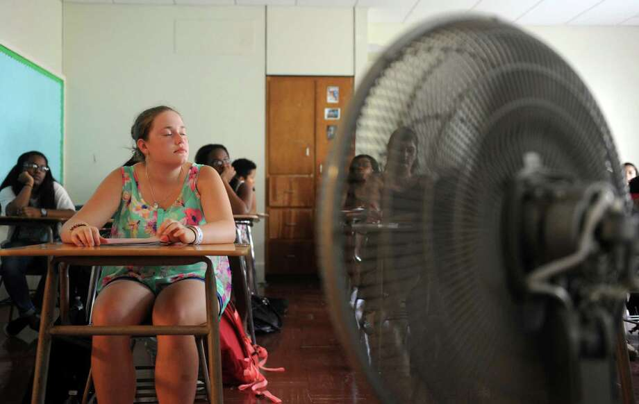 Sophomore Alexandra Samelko has a front row seat during a class titled Beats, Rhymes and Life Tuesday, Sept. 2, 2014, at Stamford High School. A fan was going in the front of the room to combat the sweltering heat for the first day of classes which could go down as the hottest day of the year. The combination of sizzling temps and high humidity pushed uncomfortable heat indexes into the upper 90s. Photo: Autumn Driscoll / Connecticut Post