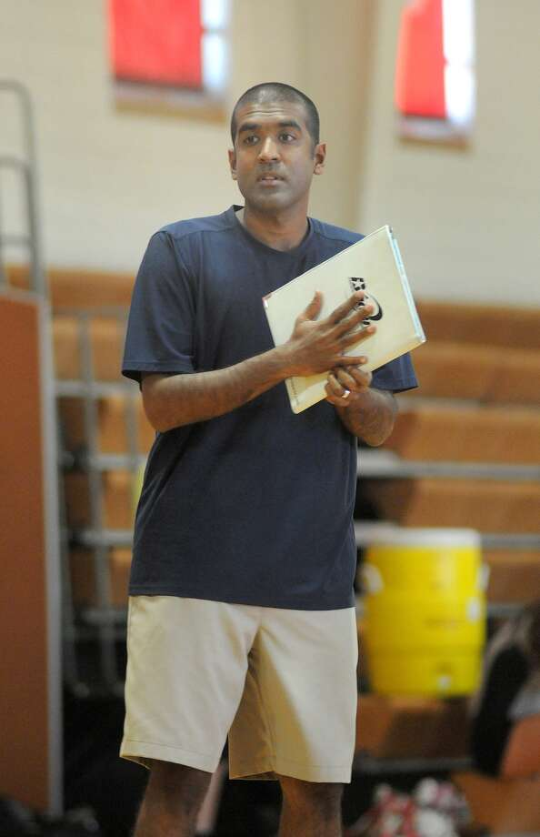 Dawson volleyball coach Jason Karim  has the Eagles flying into district play. Photo: Jerry Baker, Freelance