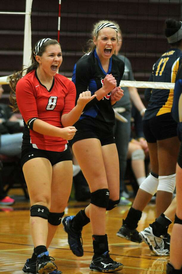 Oak Ridge sophomore libero Raigen Cianciulli, left, and senior outside hitter Victoria Harris celebrate a point against Cy Ranch. Photo: Jerry Baker, Freelance