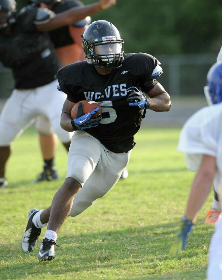 Westside High School's football team,  traveled to Cy Creek High School for a scrimmage game, 8-22-2014.  Westside running back Loren Early (5) showed some strong running back ability against Cy Creek. Photo: Eddy Matchette, Freelance / Freelance