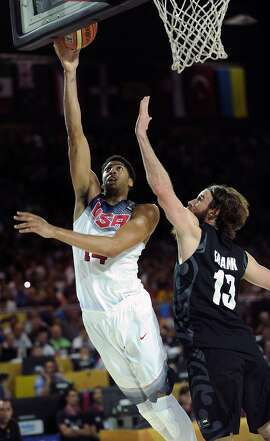New Zealand's forward Casey Frank (R) vies with US centre Anthony Davis (R) during the 2014 FIBA World basketball championships group C match USA vs New Zealand at the Bizkaia Arena in Bilbao on September 2, 2014. AFP PHOTO / RAFA RIVASRAFA RIVAS/AFP/Getty Images