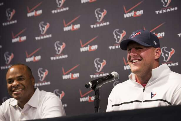 Houston Texans general manger Rick Smith, left, and defensive end J.J. Watt laugh during a news conference announcing Watt's contract extension at NRG Stadium on Tuesday, Sept. 2, 2014, in Houston. Watt agreed to a 6-year $100 million deal to stay with the Texans. ( Brett Coomer / Houston Chronicle )