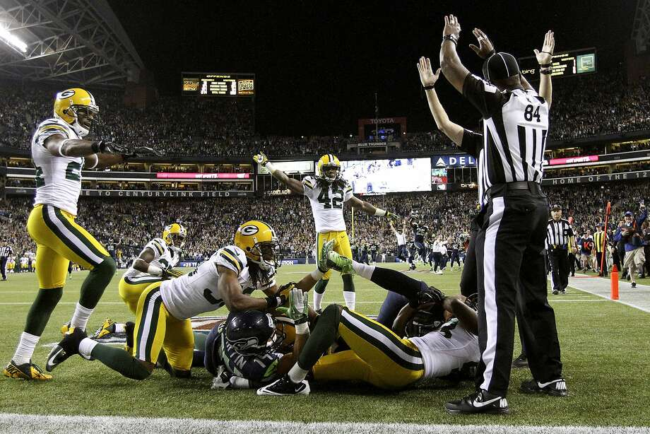 Everybody's motioning something different at the conclusion of a wild game-ending play that lifted the Seahawks in 2012. Photo: John Lok, Associated Press