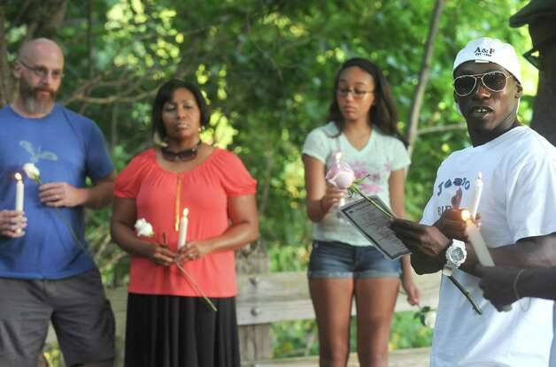 Bert Cazeau, right, speaks as friends and family gathered for a candlelit vigil in memory of Jean Albert Francillon, 27, who drowned in the Poestenkill Gorge on Monday, Aug. 25th Tuesday Sept. 2, 2014 in Troy, N.Y. .(Michael P. Farrell/Times Union) Photo: Michael P. Farrell / 00028375A