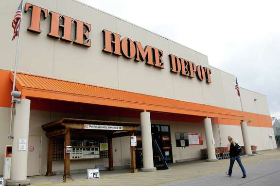 "This Aug. 14, 2012 file photo shows a Home Depot store in Nashville, Tenn. On Tuesday, Sept. 2, 2014, the home improvement retailer said that it's looking into ""unusual activity"" and that it's working with both banks and law enforcement after suspicions of a credit card data breach. (AP Photo/Mark Humphrey)"
