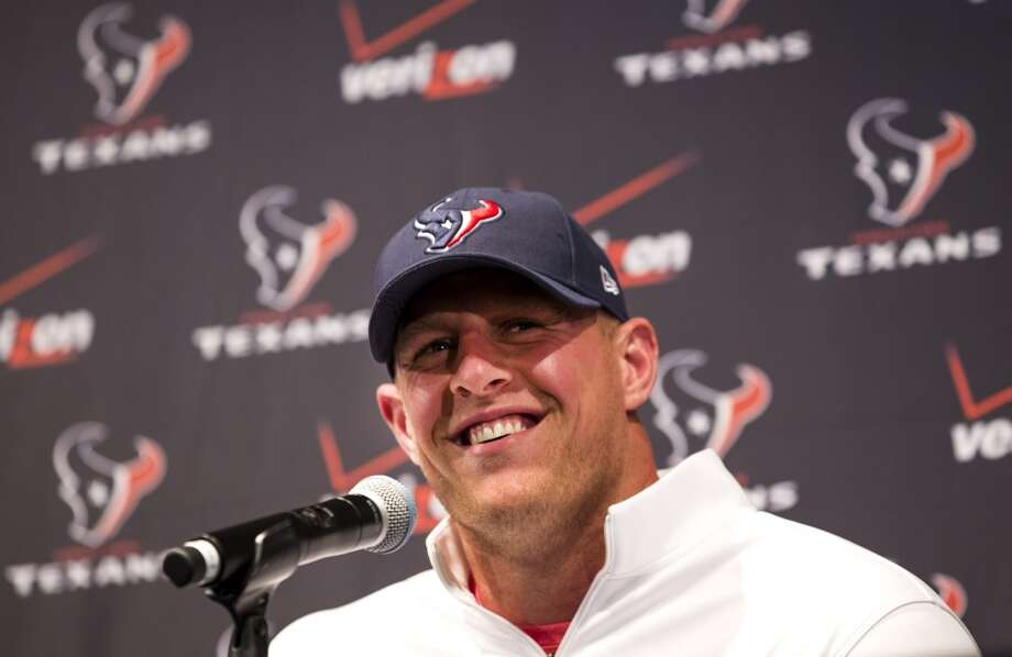 Houston Texans defensive end J.J. Watt smiles during a news conference announcing his contract extension at NRG Stadium on Tuesday, Sept. 2, 2014, in Houston. Watt agreed to a 6-year $100 million deal to stay with the Texans. ( Brett Coomer / Houston Chronicle ) Photo: Houston Chronicle