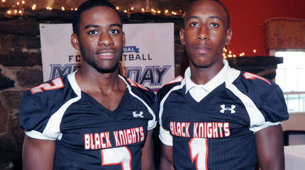 Stamford High School football players, Jalen Brown, left, the team's quarterback, and wide receiver, Ziaire Mabry, during the FCIAC Football Media Night at Zody's 19th Hole Restaurant in Stamford, Conn., Tuesday, Sept. 2, 2014.
